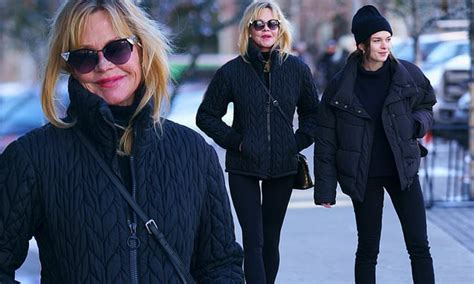 melanie griffith shows  toned legs  black tights  walking  daughter stella