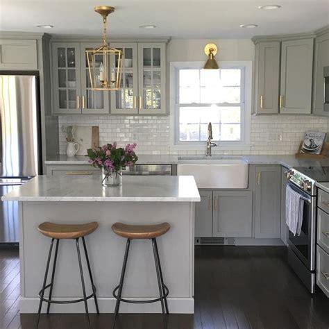 gray kitchen cabinets  lewis dolan brass bar pulls