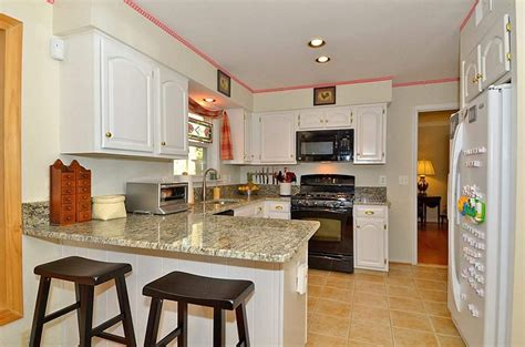 kitchen with white cabinets and black appliances buying white kitchen cabinets for your cool kitchen 9852