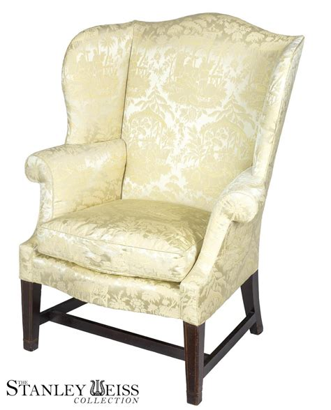 a small scale hepplewhite inlaid mahogany wing chair