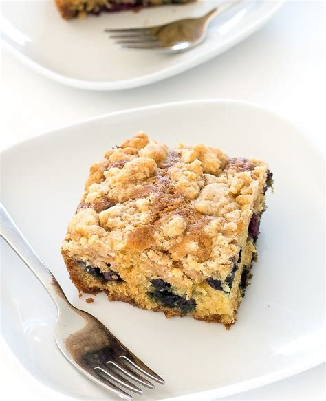 Blueberry coffee cake muffins are part muffin, part crumb cake, and entirely delicious! EASY Blueberry Sour Cream Coffee Cake - Chef Savvy