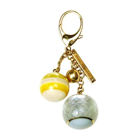louis vuitton gold yellow  blue logo ball bag charm