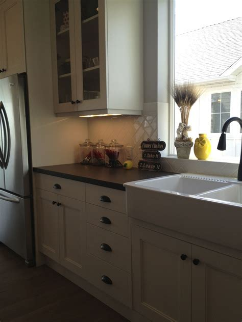 White cabinets, farmhouse sink, oil rubbed bronze hardware