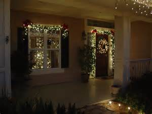 lighted garland around door and wreath merry christmas y