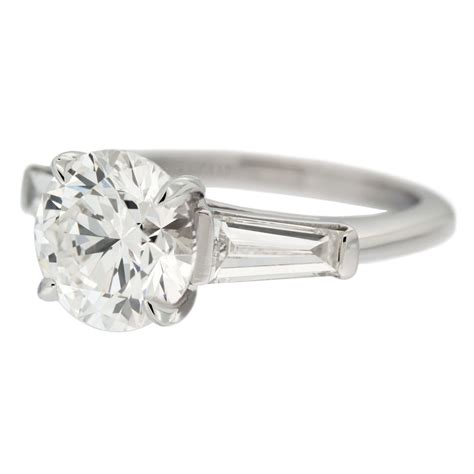 solitaire diamond engagement ring  tapered baguette
