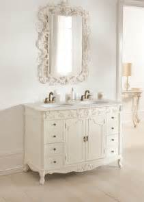 bahtroom sweet mirror edge above antique white double sink