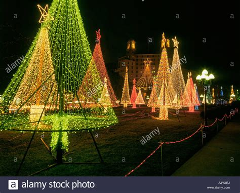 christmas lights go up on christmas trees in hot springs