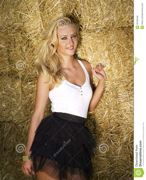Beautiful Sex Young Girl Near A Straw Bales Wall Stock