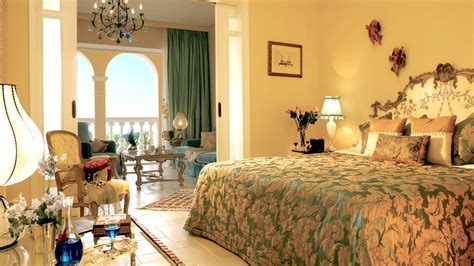 Sitting Area In Master Bedroom by Deluxe Suites Eva Palace Luxury Resort In Corfu