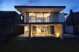 maison contemporaine avec toit terrasse et bardage bois With maison bois toit terrasse