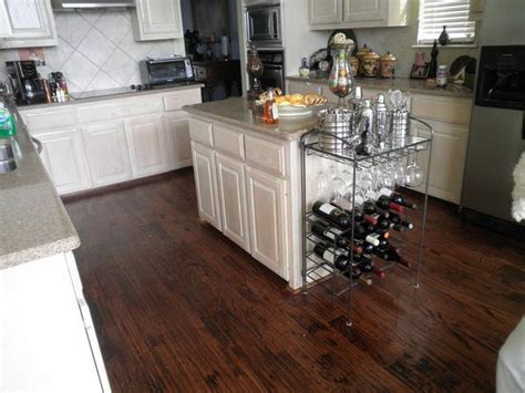 do you install hardwood floors kitchen cabinets white kitchen cabinets with hardwood floors island 9951