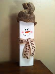 wooden snowman with burlap hat and ribbon scarf winter decoration front porches