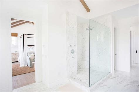 corner glass shower with marble herringbone shower floor contemporary bathroom