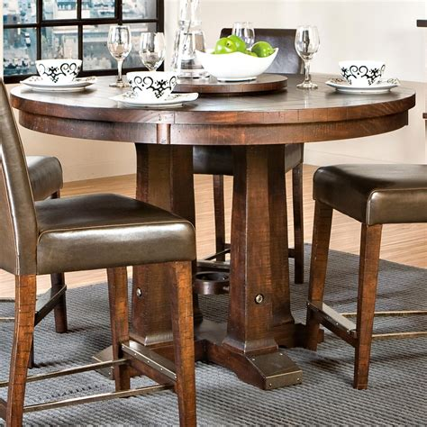dining tables intercon hayden gathering table with pedestal base 2090