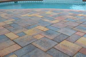 pool decking with brick pavers or travertine decking and
