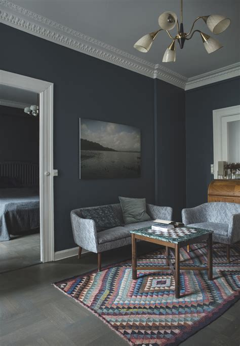 A Copenhagen Apartment with a Dark and Dramatic Interior