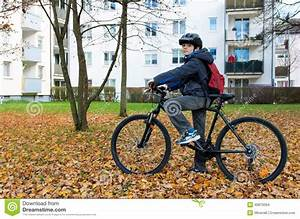 Boy child riding a bicycle stock photo. Image of face ...