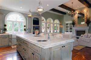 distressed white kitchen island distressed and antique white finish kitchen cabinets with parquet flooring and white marble