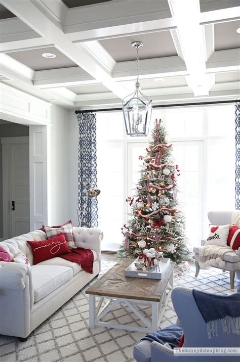 Use a red small ribbon to hang them on your wall and you are ready to have a beautifullya�warm living room. Living Room Christmas Decor - The Sunny Side Up Blog