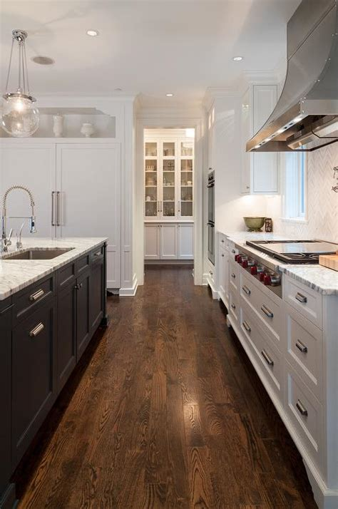 white  blue kitchen  marble herringbone backsplash transitional kitchen