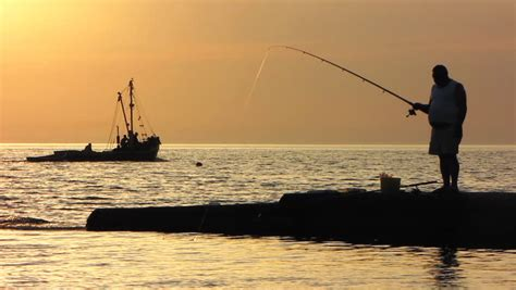 Fishing Boat Silhouette by Fly Fisherman Fishing From Boat Silhouette Stock Footage