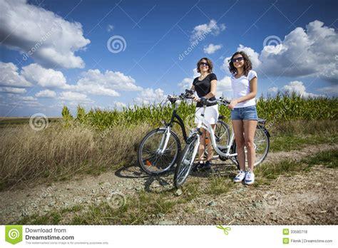 Two Girls On Bike Tour Royalty Free Stock Photos Image