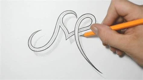 Letter M And Heart Combined  Tattoo Design Ideas For