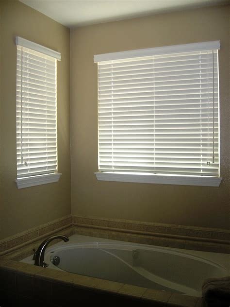Modern Bathroom Blinds modern bathroom with recessed bathtub and pictures of