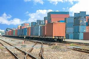 Cargo train platform with freight train container at depot ...