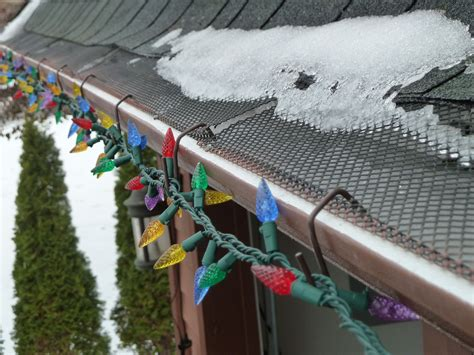 christmas lights for gutters a up using out brown hooks for gutters with mesh leaf gutter guard the brown