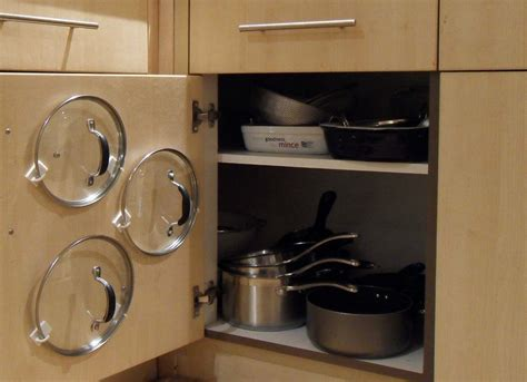 organizing pots and pans in a small kitchen use a curtain rod or command hooks to organize pot and pan 9868