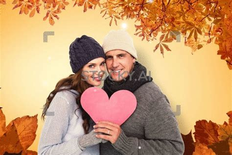 magical gif  happy couple  warm clothing holding heart