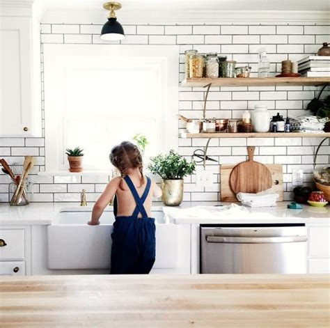 white subway tiles kitchen 25 best ideas about open shelving on kitchen 1469