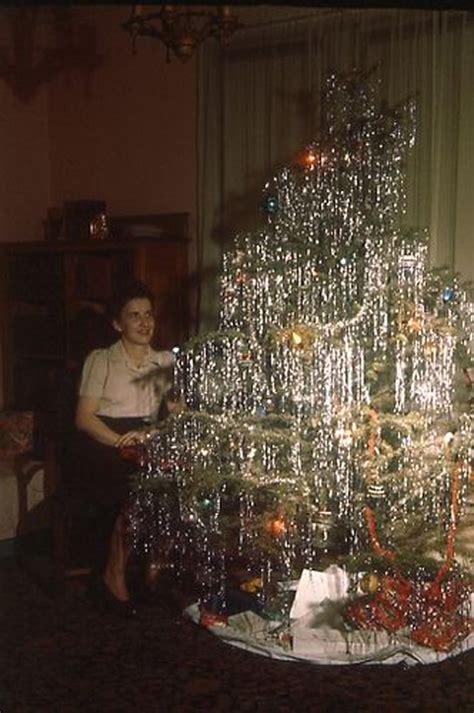 mid century women enjoying real christmas trees flashbak