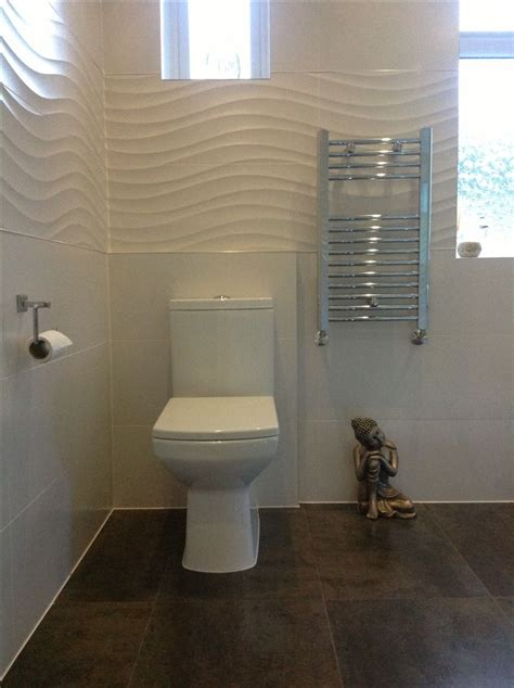 fresh white bathroom tiles  feature wave design tiles