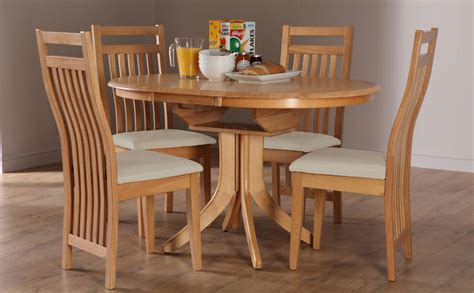 round extending dining table sets hudson bali round extending oak dining table and 4 6