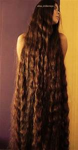 Extremely long thick hair. Wavy and chestnut brown. I'd ...