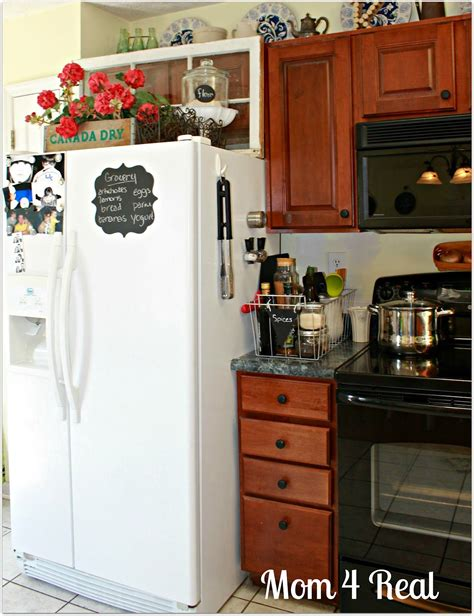 how to decorate the top of your kitchen cabinets what do you think is it totally to decorate the top