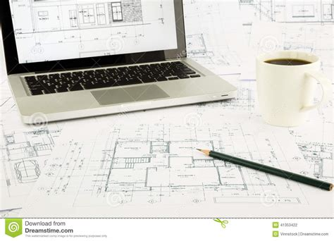 House Blueprints And Floor Plan With Laptop Stock Photo