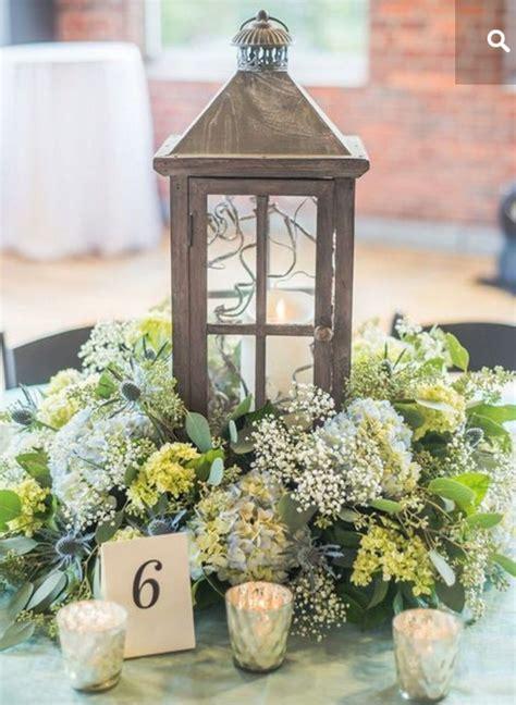 Flower Surrounding Lantern Lantern Centerpiece Wedding