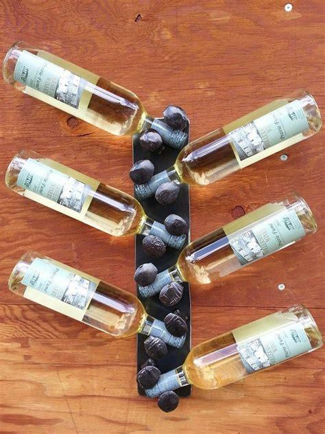 bottle wall mount wine rack repurposed  timberlakemetalworks railroad spikes wine rack