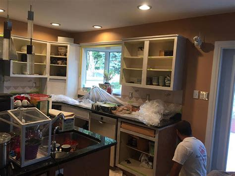 kitchen cabinet painting contractors kitchen cabinets painting ottawa on staining