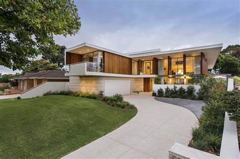 Stained Timber And Stonework Shape Midcentury Modern