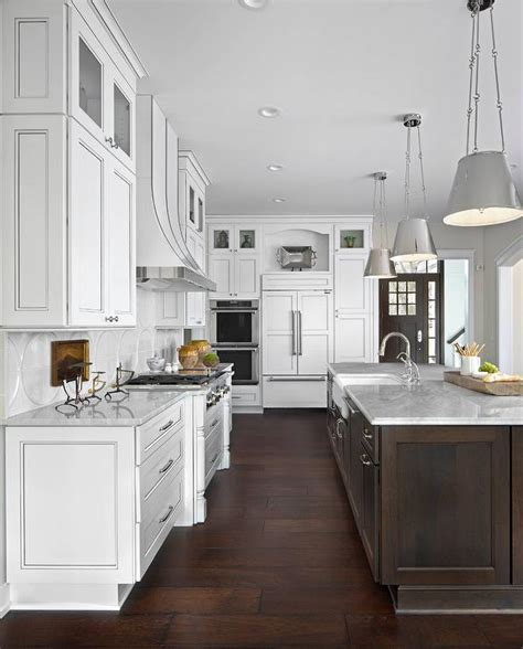 white kitchen  dark brown island  white marble
