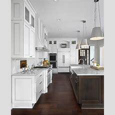 White Kitchen With Dark Brown Island And White Marble