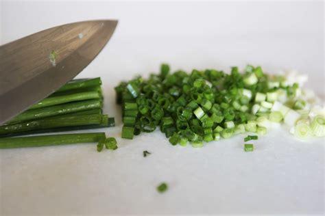 chopping green onions super scrumptious spinach dip white apron blog