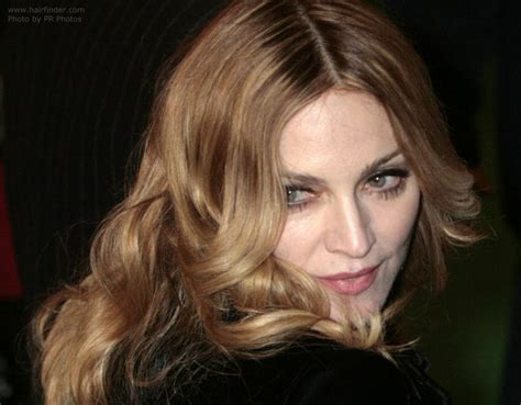 madonna wearing  long blonde hair  foiled colors