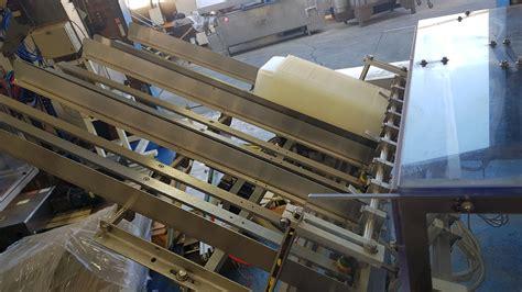 thiele technologies  head tray denesterreciprocating placer  slat chain conveyor  p