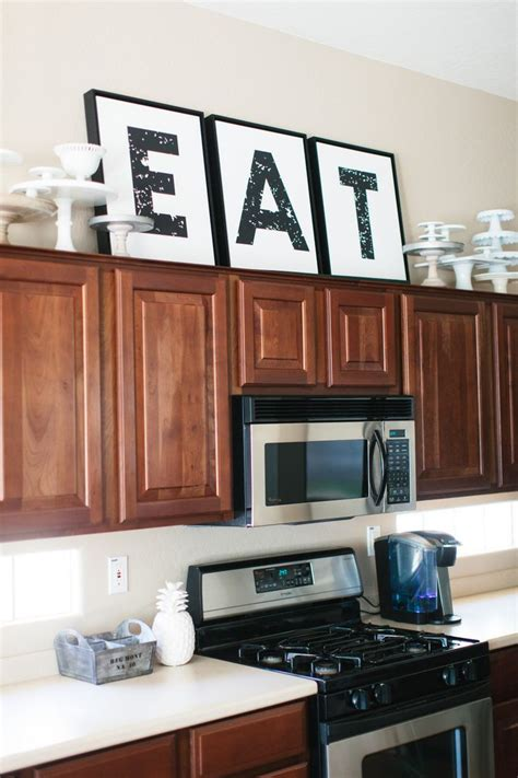 best 25 above cabinet decor ideas on pinterest