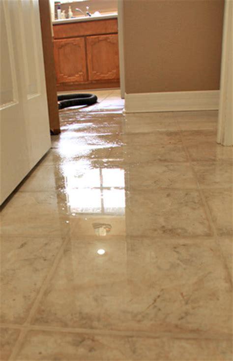 water damaged kitchen floor water damage to laminate flooring insurance gurus floor 7013